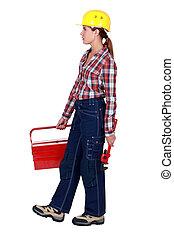 Tradeswoman going to work