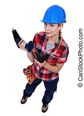Tradeswoman holding a battery-powered power tool