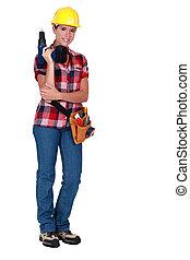 Tradeswoman holding a power tool