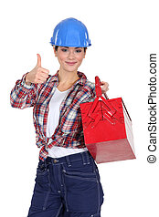 Tradeswoman holding a toolbox