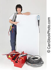 Tradeswoman pointing to a blank sign