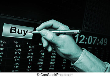 trading on stock market, pointing with pen on buy button