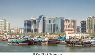 Trading wooden boats in the port timelapse. Merchant ships on the Creek Canal. Skyscrapers on background. View form bridge