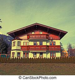 Tradition mountain wooden chalet on winter ski resort in Alps(Austria), instagram effect
