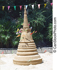 Tradition of carrying sand into the temple or monastery. Prayer flags on sand in Songkran day festival at Thailand