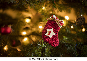 Traditional Advent Calendar Stocking with the date of the first of December hanging on a traditional christmas tree.