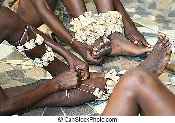 preparing for tribal hyena African dance , Basarwa bushman, San people, Botswana,