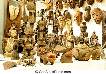 Traditional African handicraft. Wood statues in a market