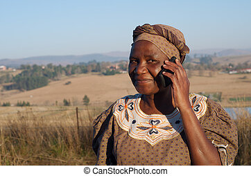 Traditional African Zulu woman speaking on mobile phone -...