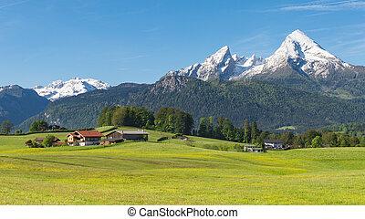 Traditional Alpine spring panoramic landscape in Berchtesgaden with Watzmann mount