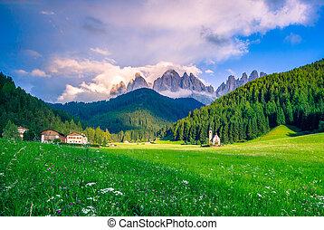 Traditional alpine St Johann church in Val di Funes valley, Santa Maddalena touristic village, Dolomites, Italy, Europe