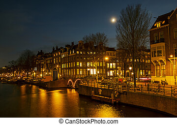 Traditional Amsterdam houses in the Netherlands at night