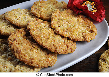 Traditional Anzac biscuits on dark recycled wood with...