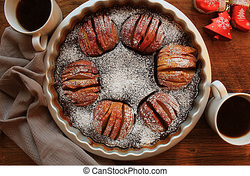 Traditional apple pie, fruit dessert, tart on wooden rustic table. Top view, christmas background