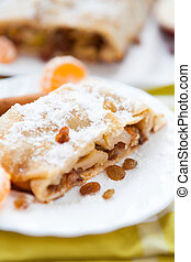 traditional apple strudel on a white plate