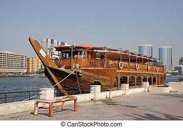 Traditional arabic boat at Dubai Creek, United Arab Emirates