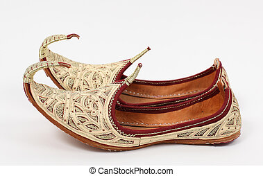 Traditional Arabic shoes over white background