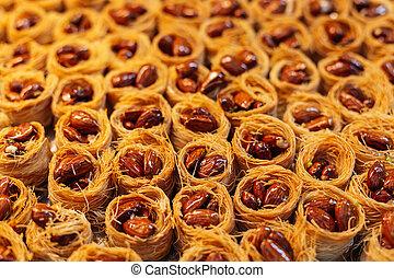 Traditional arabic sweets (dessert kadaif, kunafa, baklava) in the Jerusalem market, Israel.