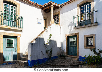 Traditional architecture of old european town. Narrow street of the ancient town. Scenic old town with medieval architecture.