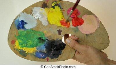 palette - traditional artist's palette creating an orange...