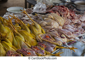 traditional asian food as poultry in different  colours offered on a week market