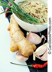 traditional asian ingredients uncooked rice, ginger, garlic,...