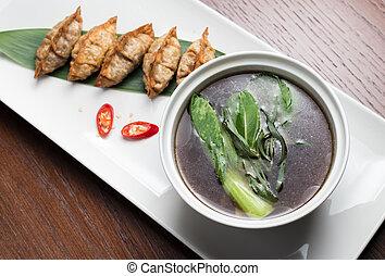 Traditional asian pan fried gyoza dumplings