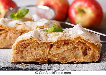 Traditional Austrian apple strudel macro on the board....