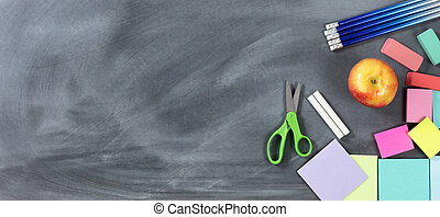 Traditional back to school objects on chalkboard
