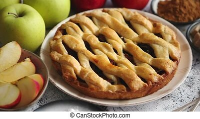 Traditional baked apple pie cake served on ceramic plate. ...