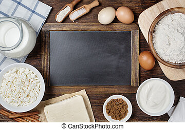 Traditional baking ingredients with vintage chalkboard. ...
