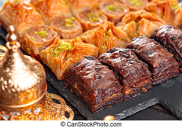 Traditional Baklava on Wooden Table. Close up. - Traditional...