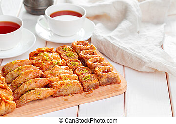 Traditional Baklava on Wooden Table creative photo. - ...