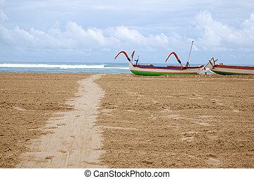 Traditional balinese jukung fishing boats on Nuca Dua beach