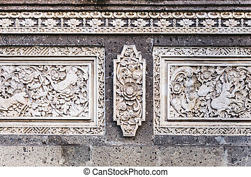 Traditional balinese stone carving, wall in temple