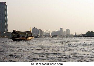 Traditional barge on Chao Phraya river in Bangkok