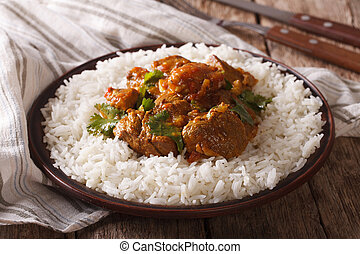 Traditional beef madras with garnish basmati rice close-up. ...
