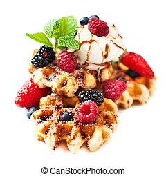 Traditional Belgium waffles with fresh fruit, caramel and ice cream isolated on white background