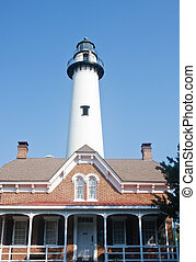 Traditional Brick Home and White Lighthouse