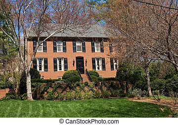 Traditional Brick Two Story on Freshly Mown Lawn