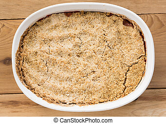 Traditional british apple crumble pie in dish