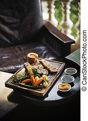 traditional british english sunday roast beef with vegetables meal