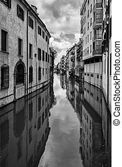 Traditional Buildings on a Canal in an Old Italian Town