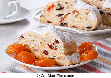 cake with raisins, dried apricots and candied slices closeup