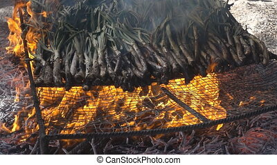 Traditional catalan calsots over the fire, slow-motion -...
