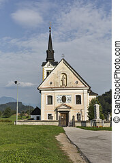 Traditional catholic church in Bohinjska Bela village near Bled, Slovenia.