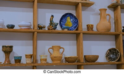 Traditional ceramic pottery store - Dolly, slider shot -...