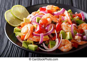 Traditional ceviche seafood with vegetables and lime close...