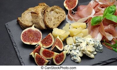 traditional cheese and meat plate wth parma, parmesan and...