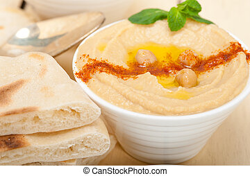 Hummus with pita bread - traditional chickpeas Hummus with ...